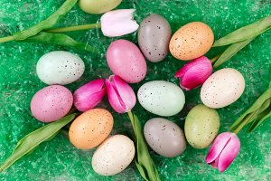 Tulips and Easter eggs on grass