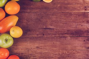 Fruits on wooden texture background