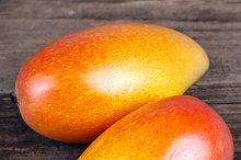 Mango on wooden texture background