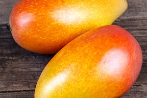 Mango on wooden texture background
