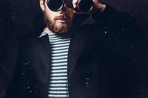 Sailor man with binoculars