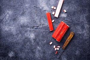 Crab sticks surimi and knife