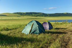 Two tents, a landscape.