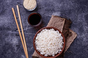 Bowl of boiled rice and chopsticks