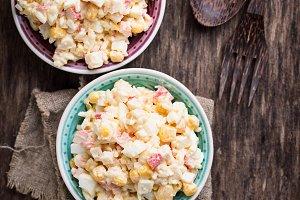 Salad with crab sticks, rice and corn