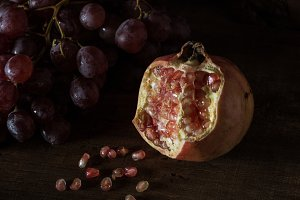 Rustic pomegranate and grapes