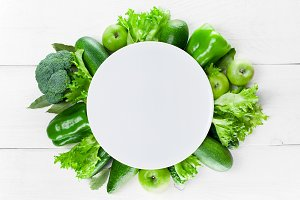 Empty plate and green vegetables