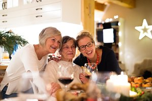 Mother, grandmother and daughter celebrating Christmas.
