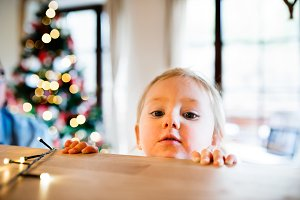 Little girl in kitchen at Christmas time.