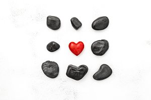 Red heart and black stones