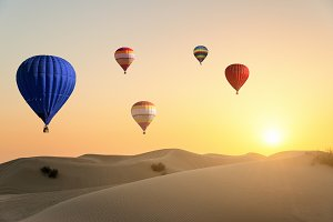 Hot air ballons flying over desert