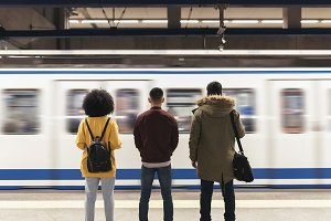 Group of friends waiting the train.