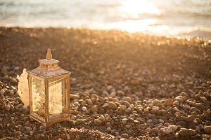 White rustic lantern on the pebble