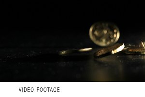 Gold coins falling over dark back