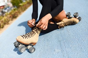 Woman puts on roller skates