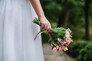 Boquet of rose flowers in bride hand