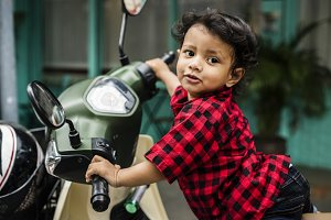 Young Indian boy riding motorbike