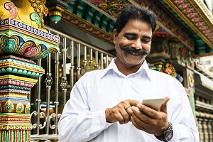 Indian people using mobile phone