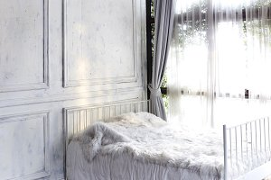 white bedroom with window and curtai