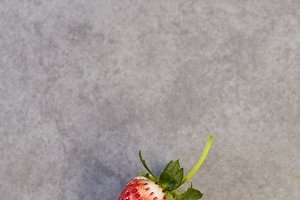 Fresh strawberry on gray
