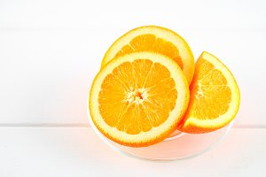 Orange slices on a white wooden table. Healthy food, drinks.