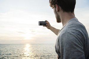 Caucasian man taking a photo