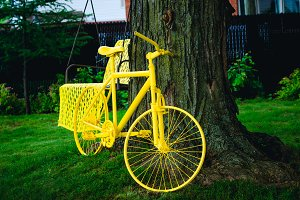 Yellow fancy bicycle parked