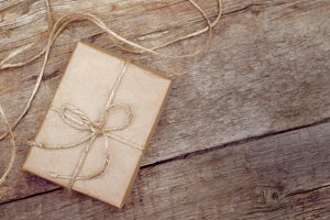 Brown gift box on wooden background.