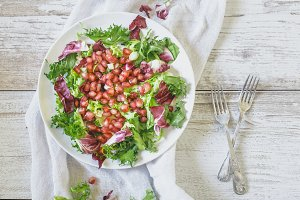 Healthy vegetarian salad on board