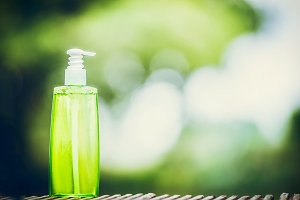 Green cosmetic product bottle