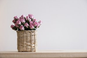 Pink paper roses in basket