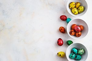 Colored easter eggs on a light background,place for text