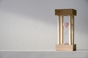 Hourglass or Sandglass on the table