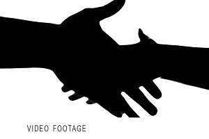 Shaking hands of two people