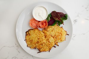 Potato fritters with salmon fillet