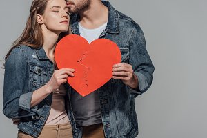 shot of young couple holding heart