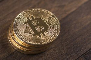 Bitcoin coins on brown wood. Cryptocurrency