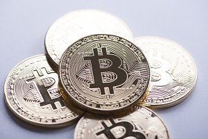 Several Bitcoin coins on white background. Cryptocurrency