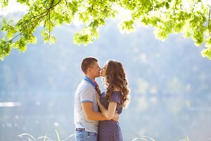 Loving couple together on grass near