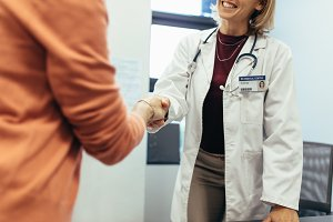 Friendly doctor shaking hands