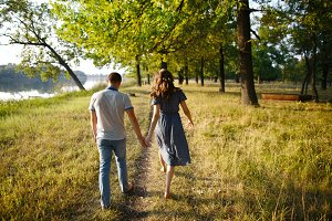 Loving couple holding hands and walk