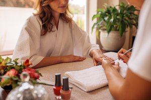 Manicurist shaping and polishing