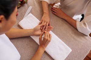Woman hands receiving manicure