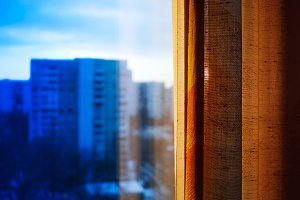 City window with curtain bokeh background