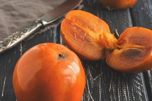 Ripe persimmon on a wooden table