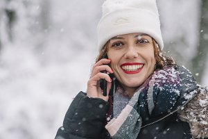 young girl smiling in the snow