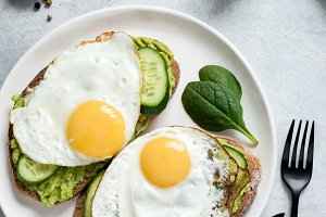 Fried egg avocado and cucumber toast