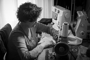 Woman sewing in black and white