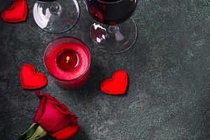 Valentines day greeting card concept. Wine glasses, rose and candle