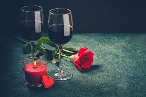 Valentines day greeting card concept. Wine glasses, rose and can